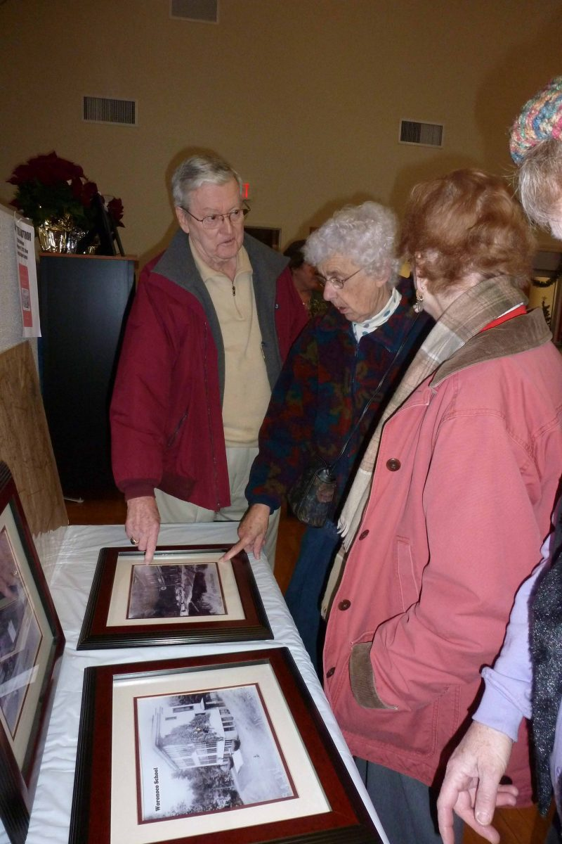 Left to right: Dick Arnold, Jane Castro, Carol Burke look at display at Woronoco Open House Exhibit at Russell Senior Center.  (Photo submitted)