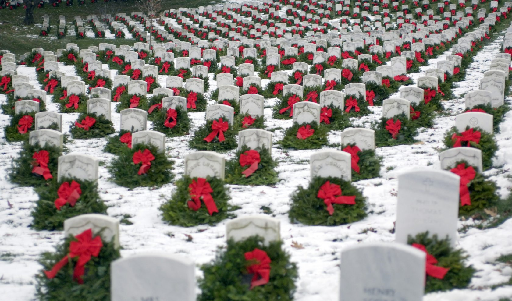 Hundreds of volunteers will gather at Arlington National Cemetery to place  thousands of donated Christmas wreaths on head stones on Dec. 15. (U.S. Air Force photo by Master Sgt. Jim Varhegyi)