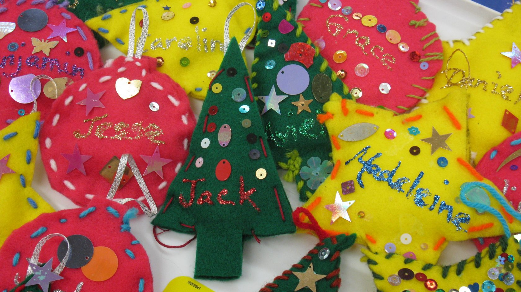 Westfield High School students in Mrs. West and Ms. Picard's art classes, as well as their after- school Art Club, have been busy this week making ornaments in memory of the students and teachers from Sandy Hook Elementary School.  Upon listening and hearing that they needed ornaments for a tree in memory of those killed, our students were anxious to do what they could to show that they care.  Some students even made ornaments at home to be delivered.  Mrs. Drewnowski created a giant card which was signed by all the students with thoughtful wishes during this extremely difficult time.  Our students were proud to be a part of this community service project, and in turn, we are extremely proud of them.  (Photo submitted)