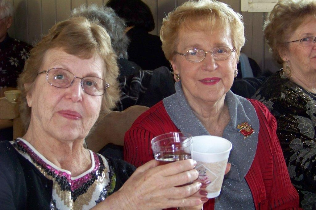 Rose Crawford, left, and Barbara Bream enjoy the food at the YMCA Active Older