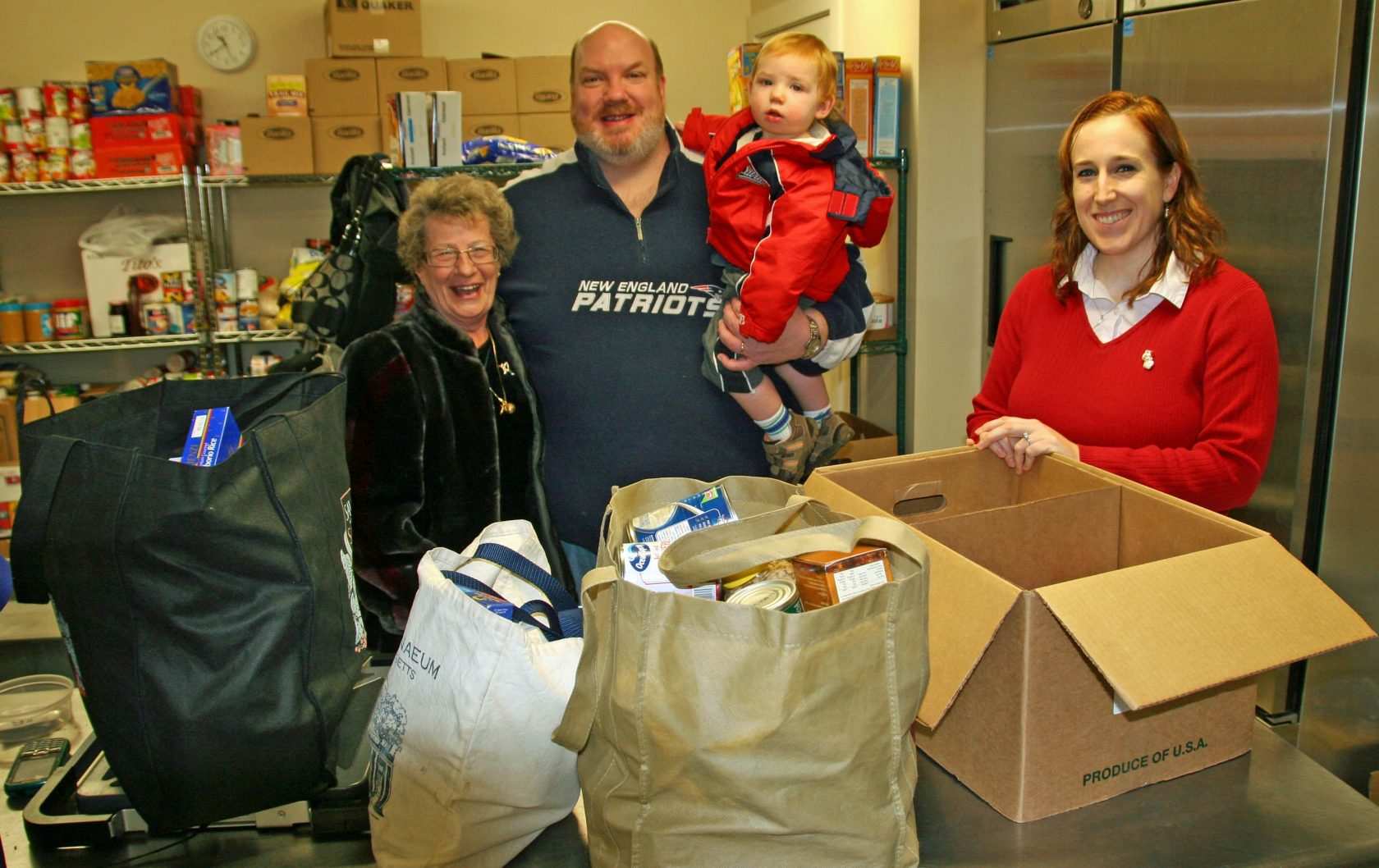 On the day before Christmas, State Representative  Don Humason dropped off a generous donation of canned goods to the Westfield Food Pantry at 101 Meadow Street, as a result of his annual sponsored Christmas skate party at Amelia Park Skating Rink.  Left to right, Dotty Noe, volunteer,  Rep. Don Humason, Quinn Humason, and volunteer, Tara Labucki.  (Photo by Don Wielgus)