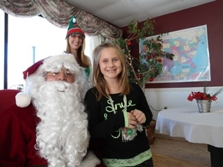 """A child attending the 'cookies with Santa' event at Renaissance Manor