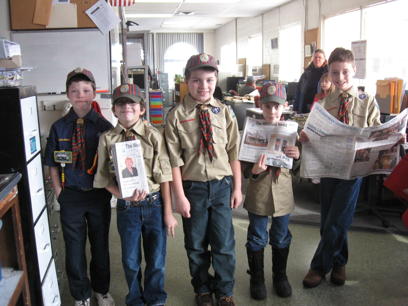 The Webelo Den from Cub Scout Pack 820 in Westfield spent part of their Christmas break learning about various businesses and one of them was The Westfield News Group. Shown here are  (L-R) Nicholas Paulson, Matt Thayer, Corey Farnsworth, Jake Falcetti and Sam MacMunn in the newsroom of The Westfield News Group.  (Photo submitted)