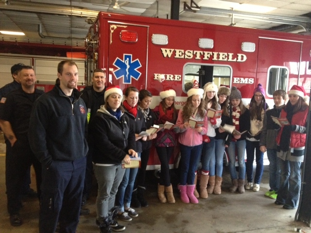 The South Middle School Builders Club for Kiwanis. Victoria Sardinha, Alayna Miller, Emma Reynolds, Katie Knapik, Devin Callaghan, Miranda Boudreau, Patrick Lurgio, Elizabeth Irwin, Sofia Macias along with teachers, Sam Petrillo and Ali Curto sing carols at the fire department headquarters on Broad Street.  (Photo submitted)