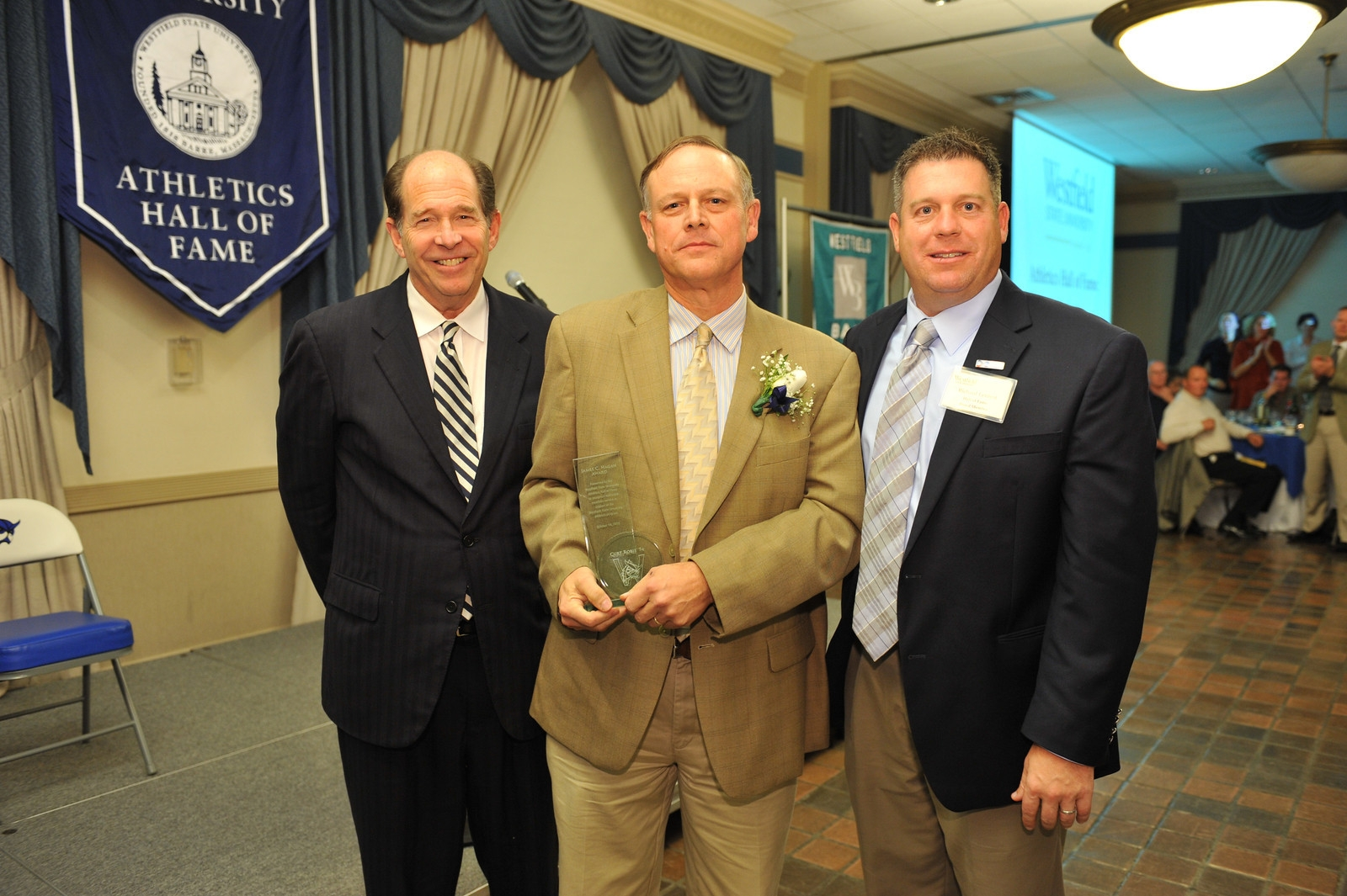 Pictured, left to right, are: Westfield State President Evan S. Dobelle, Curt Robie, and Westfield State athletics director Richard Lenfest. (Courtesy of WSU SID)