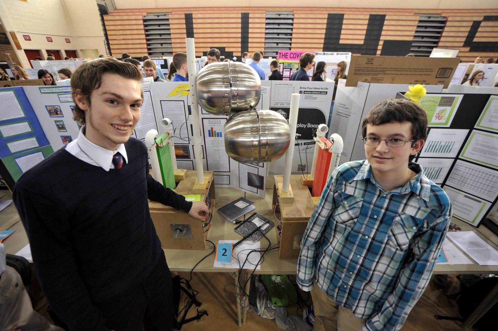 Westfield High School students Ian Coddington and Shawn Farnham explain how their Van De Graaff Electric Generator will create enough energy to send a bolt of lighting through the air. Safety regulations prevented the hands-on demonstration in the school gymnasium so a video of the generator at work was shown on a laptop computer.  (Photo by chief photographer Frederick Gore)