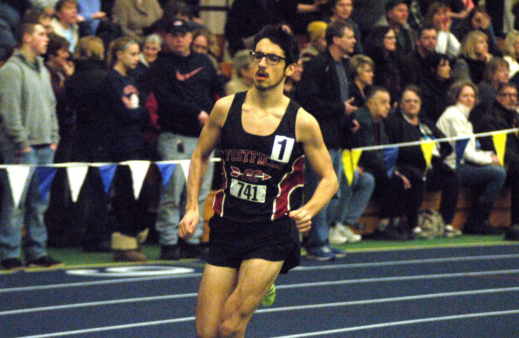 Westfield's Blake Croteau rounds the track during Monday's PVIAC championship meet at Smith College in Northampton. Croteau won the mile and 2-mile event. (Photo by Chris Putz)
