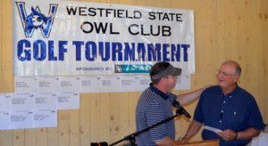 Westfield State athletics director Richard Lenfest, left, congratulates Ray Arra during the Owl Club golf tournament dinner. Arra, who retired this year as baseball coach, was a special guest of honor at the annual tournament along with cheering coach Lisa Moskow. (Photo by Mickey Curtis)
