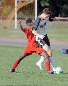 Southwick's Jonathan Collins, right, attempts to take control of a loose ball as Commerce midfielder Kymani Dayer moves in. (Photo by Frederick Gore)