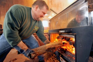 Harlow Pomeroy fills the evaporator at his maple sugar house in Westfield. (File photo by Frederick Gore)