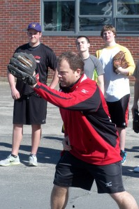 """First-year Westfield Voc-Tech head baseball coach Kyle Dulude instructs his players during a """"spring"""" training practice in the school parking lot. Dulude, the school's former head softball coach, has taken over the team following longtime head coach Clem Fucci's retirement this past offseason. (Photo by Chris Putz)"""