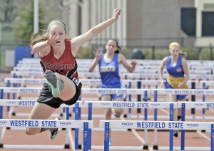 Westfield's Morgan Sanders, left, clears the 100-meter high-hurdles during a track and field meet at Westfield State University last spring. Sanders has been flying high again this winter during indoor track season. (Photo by Frederick Gore/www.thewestfieldnews.smugmug.com)