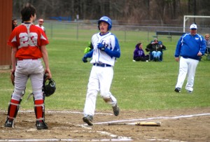 Gators' Calvin Dowers scores a run in the bottom of the first inning Wednesday. Dowers reached base on a double. (Photo by Chris Putz)