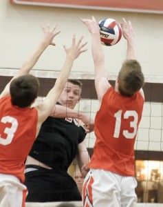 Westfield's John Bucko, rear, spikes the ball to Agawam's Benjamin Cassidy during a match in Agawam in May. (File photo by Frederick Gore)