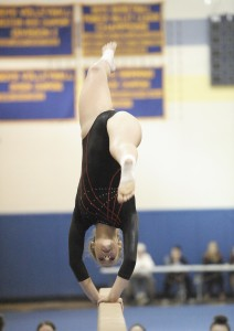 Westfield's Liz Walker performs her routine on the balance beam. (Photo by Frederick Gore)