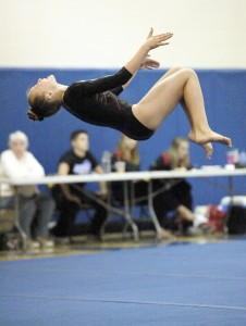 Westfield's Courtney Berry performs her floor routine during Tuesday night's gymnastics tri-meet opener at Chicopee Comp. (Photo by Frederick Gore)