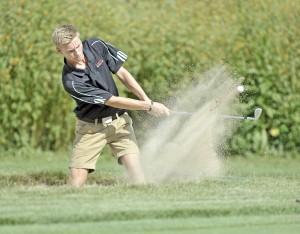 Westfield golfer Sebastian Soendergaard chips from a sand trap earlier this season. (Photo by Frederick Gore)