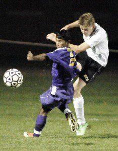 Westfield Voc-Tech's Laxmi Basnet, left, and St. Mary's Seamus Butler battle for a loose ball during Tuesday night's game under the lights of Bullens Field. (Photo by Frederick Gore)