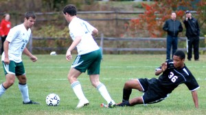 Westfield's Dante White (36) comes to a skid after soaring for the ball against Minnechaug Wednesday. (Photo by Chris Putz)