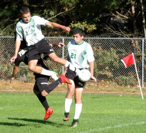 St. Mary's Kieran O'Donnell, left, goes airborne for the ball during a high school boys' soccer game against Pioneer Wednesday at Jachym Field. Saints' Zac Girard, right, steps into the play.
