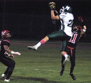 Minnechaug goes airborne for one of several catches in Friday night's football game against host Westfield. (Photo by Chris Putz)