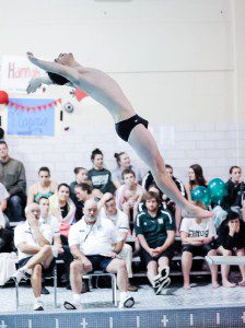Westfield High School senior captain James Wagner performs a 201A Back Dive, Straight, during Wednesday's home meet against Minnechaug. (Photo by Frederick Gore)