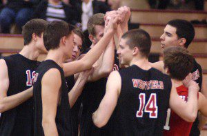 Members of the Westfield High School boys' volleyball team join forces to take on all of Western Mass this postseason. (File Photo by Chris Putz)
