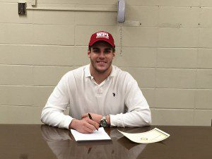 WHS senior wrestler Austin Shrewsbury signs his letter of intent to attend Worcester Polytechnic Institute in late March. (Submitted photo)