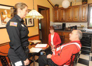 Westfield Fire Captain Rebecca Boutin and Red Cross volunteer Jack Hawley explain some fire safety procedures to resident Geraldine Brennan during a Red Cross sponsored program to service and update smoke and carbon monoxide detectors in her home. (Photo by Carl E. Hartdegen)