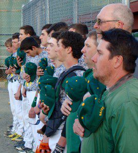 Players and coaches for St. Mary stand for the national anthem Wednesday night. (Photo by Chris Putz)