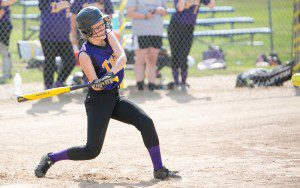 Kate Nesmolova swings at an incoming pitch from the Tigers opponent, Pathfinder. (Photo by Liam Sheehan)