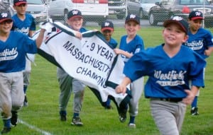 """The Westfield Little League Baseball 7-9-Year-Old American All-Stars display their championship banner as they jog around the field to the tune of """"We are the Champions"""" after capturing the age division's first-ever All-Star title. (Photo by Chris Putz)"""
