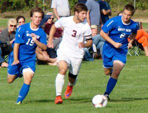 Bombers' Matt Butera attempts to split a pair of West Side Terriers Friday at Westfield High. (Photo by Chris Putz)