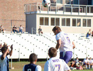 Tigers' Alex Stepanchuk (8) leaps for a header. (Photo by Chris Putz)