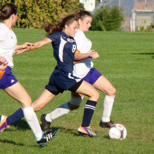 Westfield Technical Academy and Hampden Charter School of Science (8) battle for the ball Thursday at Jachym Field. (Photo by Chris Putz)