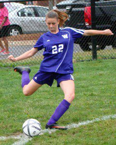Westfield Technical Academy's Sydnie Brock steps into a kick at Commerce Thursday. (Photo by Chris Putz)