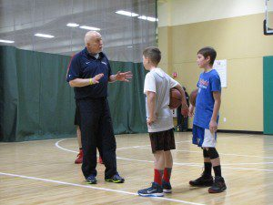 Dr. Steve Sobel instructs local grade school ballplayers Ryan Phillips and Adam Garstka, of Westfield during a coaching session last February at Arbors indoor basketball facility in East Longmeadow. (Submitted photo)