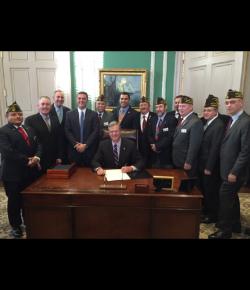 Baker signs Velis' Stolen Valor bill into law
