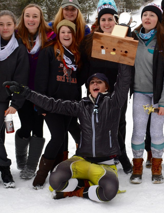 Westfield's Grace O'Connor shows her jubilation by raising the regular season team trophy high above her head late Tuesday afternoon at Berkshire East in Charlemont. (Photo by Chris Putz)