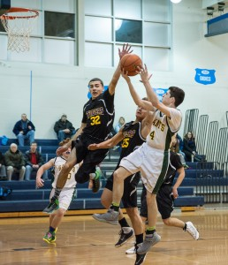 Westfield Technical Academy's Andrew Czerechma (32) extends an arm as he attempts to make a soaring block on a shot from Alex Qiu (4) Monday night at Westfield Middle School South. (Photo by Bill Deren)