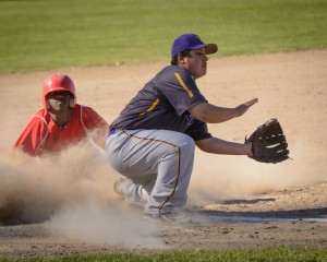 Tanner Hart tries to make the play at third base. (Photo by Marc St. Onge)