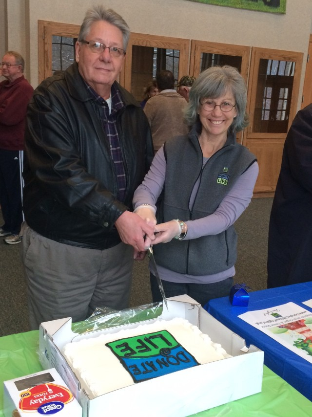 Paul Hood and Susan Sanders cut a Donate Life cake Monday at Southwick Town Hall during a ceremony recognizing April as Donate Life month. (Photo by Hope E. Tremblay)