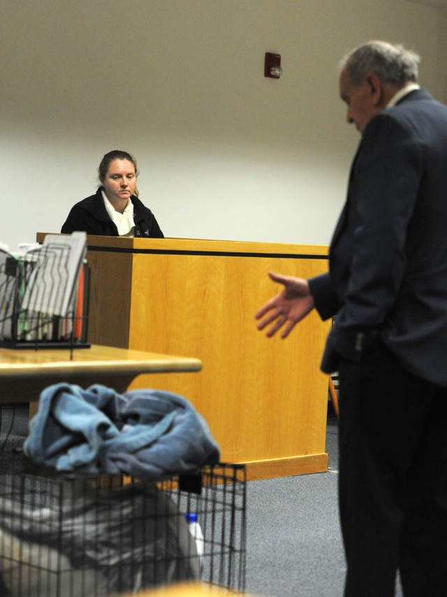 Attorney Thomas D. Whitney refers to a crate in which a dog was confined when it was soaked with bleach as he questions his client, Jennifer Gingras of Holyoke, during her trial on a charge of cruelty to an animal in Westfield District Court last week. Gingras was found guilty of the crime. (Photo ©2016 Carl E. Hartdegen)