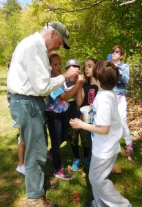 Students gather seeds for a germination project with naturalist Ted Watt at Russell Elementary. (Photo by Amy Porter)