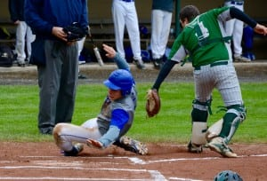 Gateway's Joe Jones avoids the tag of the Indians' catcher to score the team's first run of the game Wednesday at Veterans Field in Ware. (Photo by Chris Putz)