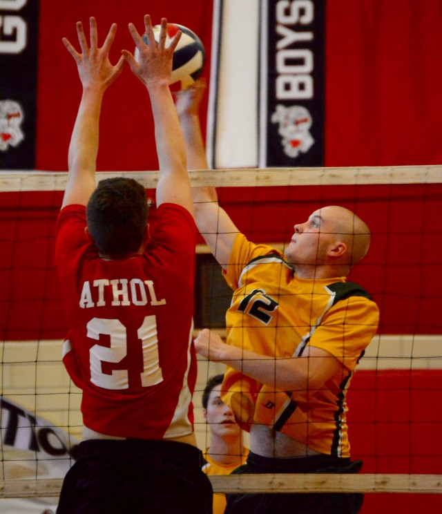 Southwick's Jack Lebo (right) attempts to elevate high above the Athol defense in Thursday's Western Massachusetts Division 1 high school boys' volleyball tournament opener. (Photo by Chris Putz)