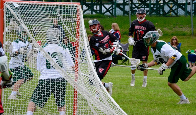 Westfield's Mason Balch fires a shot at Minnechaug's net Tuesday. The attempt sailed just wide. (Photo by Chris Putz)