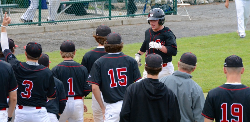 Westfield catcher Anthony Clark is greeted by teammates at home plate after hitting a home run Saturday. (Photo by Chris Putz)