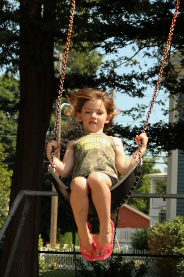 Willow, age  6, is having fun on the swings during this week's Westfield Park & Rec Adventure Zone. (Photo by Kellie Adam)