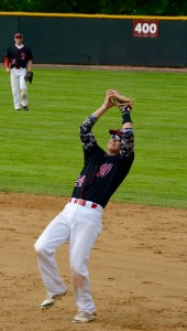Westfield first baseman Sean Moorhouse squeezes his glove to secure an out on a pop fly. (Photo by Chris Putz)